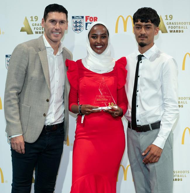 You're stars: Asha and Ali receive their award from Gareth Barry