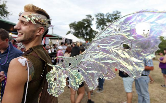 Claudio Bobicchio, 24, jokes with friends while attending the Pride Bigger Than Texas Festival & Parade held Saturday June 30, 2012 at Crockett Park.