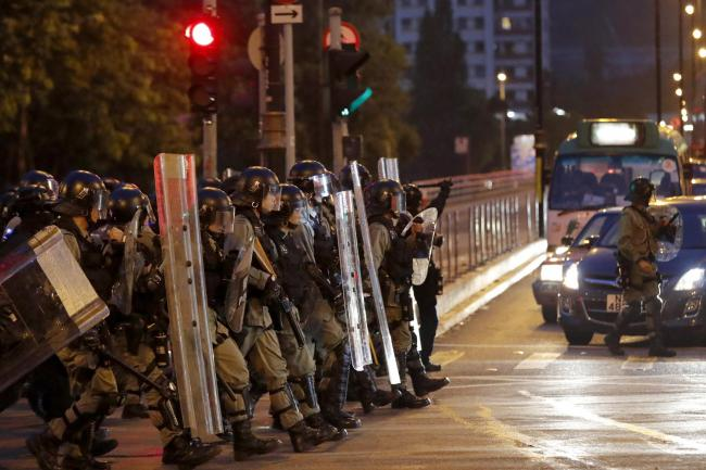 Hong Kong police fire tear gas as protesters defy ban   Ealing Times