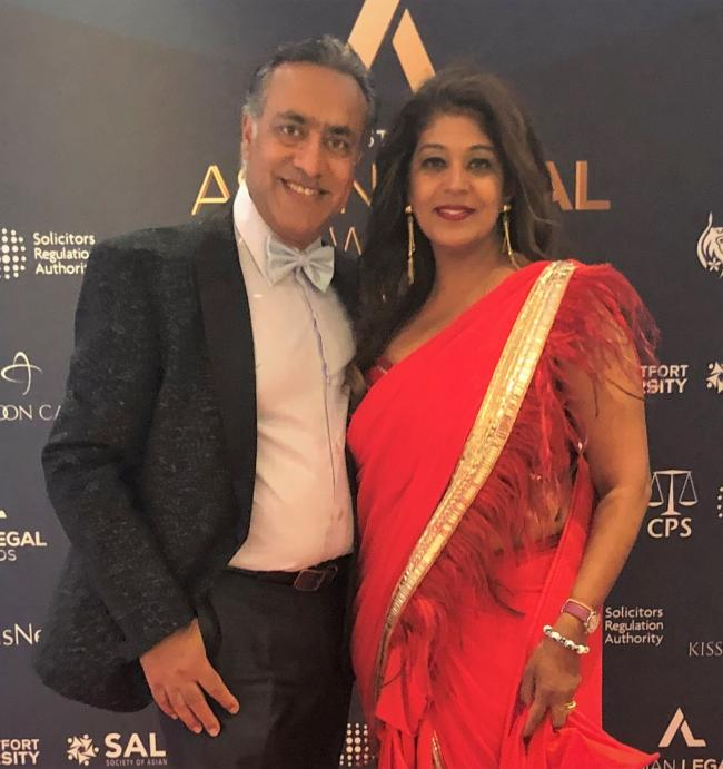 Her husband (left) and Ritu Sethi (right) at the lifetime acheivement award ceremony