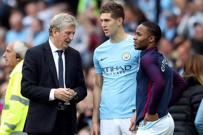 Roy Hodgson (left) is convinced there is more to come from John Stones (centre)