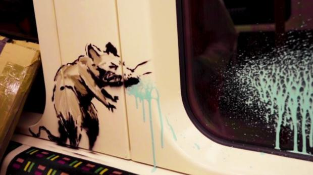 Ealing Times: Banksy's sneezing rat reminds us of the dangers of passing on the virus on public transport (Photo: Banksy).