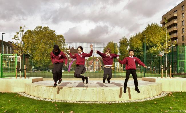 Jumping for joy: children from Berrymede School celebrate the reopening