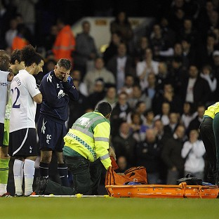 A medical team tend to Bolton Wanderers' Fabrice Muamba after he collapsed during a match with Tottenham Hotspur