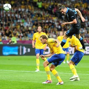 Ealing Times: England's Andy Carroll scores the first goal of the Euro 2012 game against Sweden at the Olympic Stadium in Kiev, Ukraine