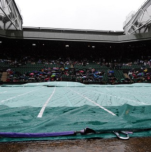 Play began on Centre Court at 1pm before a shower sent the court covers into action