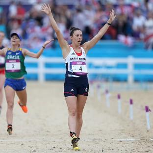 Great Britain's Samantha Murray crosses the line in second place to win silver medal in the women's pentathlon
