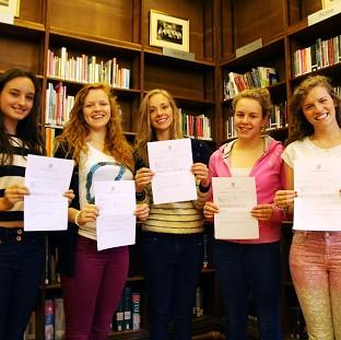 Central Newcastle High School students, from right, Rebecca Bland, Liz Hierons, Sophie Thompson, Emily Wilson and Hannah Knox get their A-level results