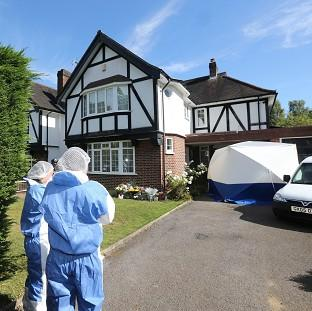 Ealing Times: Forensic officers outside the home of the French shooting victim in Claygate, Surrey
