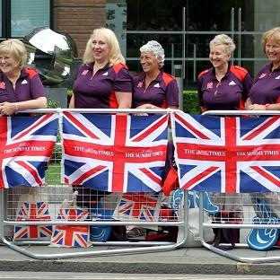Gamesmakers line the route of the Great Britain Athletes Victory Parade near St Paul's Cathedral