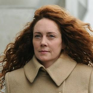 Rebekah Brooks arrives at the Old Bailey in London to face charges linked to the investigation into phone hacking