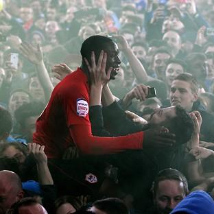 Leon Barnett was held up after Cardiff fans invaded the pitch following their promotion to the Premier League