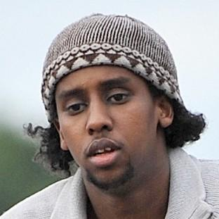Mohammed Ahmed Mohamed, who escaped wearing a burka, is facing 20 charges for breaching orders.