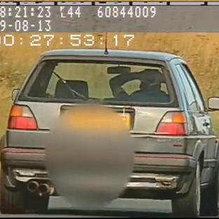 Ealing Times: Video still issued by North Yorkshire Police showing Richard Newton, 36, driving at 60mph with no hands on the A171 near Scaling Dam reservoir in August of last year, as he has been banned from driving for 12 months at Scarborough Magistrates Court.