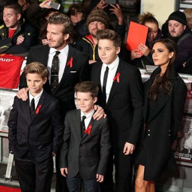 Ealing Times: David and Victoria Beckham with their children Brooklyn, Romeo and Cruz