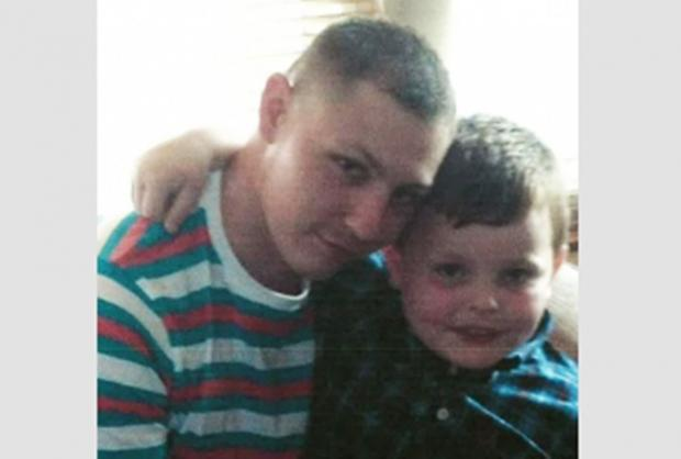 Dean, seen here with his nephew, was fatally stabbed in Greenford