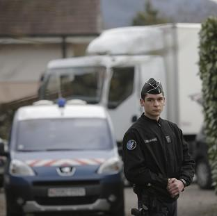 Police in the French Alps are questioning a man over the murders of a British