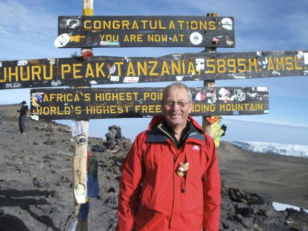 Peak of condition: Andy James atop Kilimanjaro with his grand-daughter's teddy bear