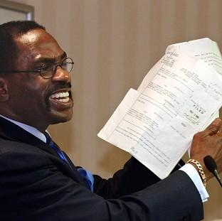 "Ealing Times: Former boxer, Rubin ""Hurricane"" Carter,  holds up the writ of habeas corpus that freed him from prison"