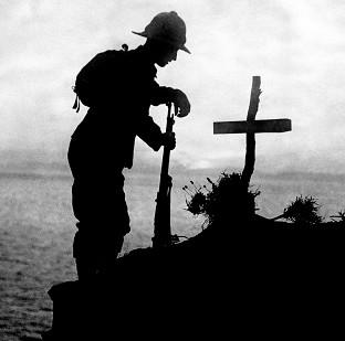 Ealing Times: A soldier pays his respects at the grave of a colleague near Cape Helles, where the Gallipoli landings took place