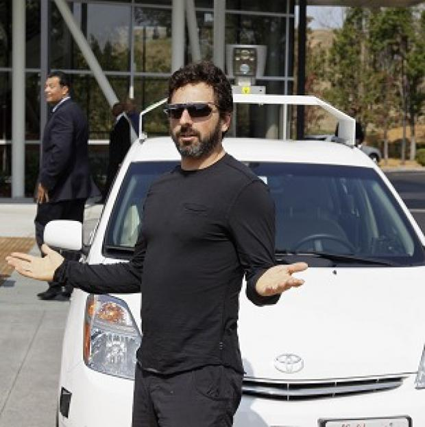 Ealing Times: Google co-founder Sergey Brin with a driverless car in Mountain View, California