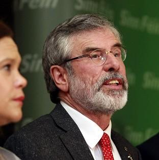 Ealing Times: Gerry Adams speaks to the media in Belfast after his release following five days of police questioning (AP)
