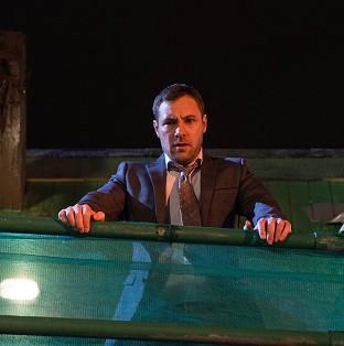 ITV handout photo of Coronation Street killer Rob Donovan played by Marc Baylis, as he looks down on the body of barmaid Tina McIntyre, played by Michelle Keegan.