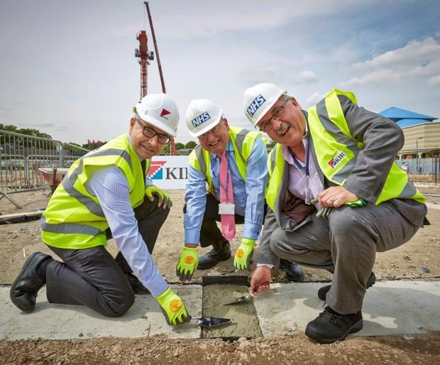 Job well done: Picture shows (from left): Colin Lamb, managing director of Kier,  Nigel McCorkell, chairman of West London Mental Health NHS Trust and Steve Shrubb, chief executive