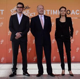 Ealing Times: Foreign Secretary William Hague (centre), Brad Pitt and Angelina Jolie arrive at the End Sexual Violence in Conflict Summit at the Excel centre in east London.