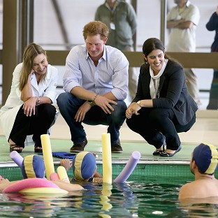 Prince Harry meets patients in the Rede Sarah Hospital for Nerological Rehabilitation injuries during his visit to the hospital in Brasilia