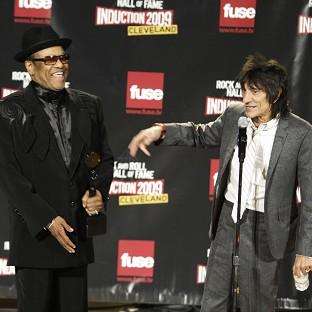 Bobby Womack, left, and Ronnie Wood backstage after Womack was inducted into the Rock and Roll Hall of Fame in 2009 (AP)