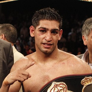 Boxer Amir Khan was arrested over an alleged assault in Bolton