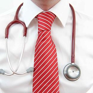 A doctor poses with a Stethoscope around the neck
