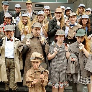 Sherlock Holmes fans at University College London as they attempt to set a Guinness World Record for the greatest number of people dressed as the famous sleuth