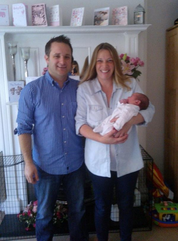 Proud mum and dad with baby Olivia back home in Pitshanger
