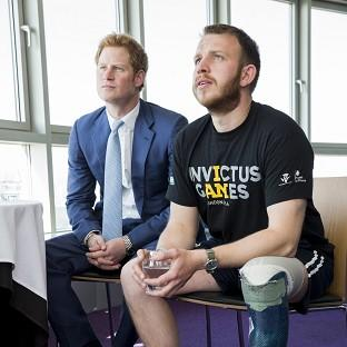 Prince Harry (left) joins former soldier Daniel Whittingham at the ticket launch of the inaugural Invictus Games