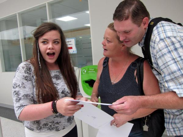 Yes! Kirsty Jones discovers her results, along with mum Alison and step-dad Jason