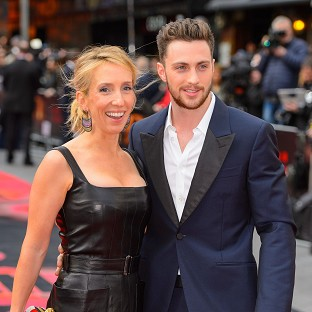 The gun, a deactivated M16 assault rifle, had been given to Sam Taylor-Johnson (left) as part of an art project