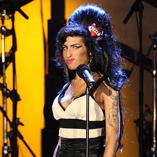 Amy Winehouse performs during the H