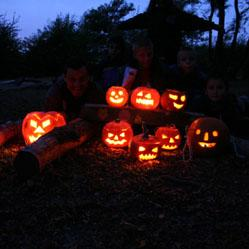 The kids lit up Ruislip woods with their scary pumpkins.