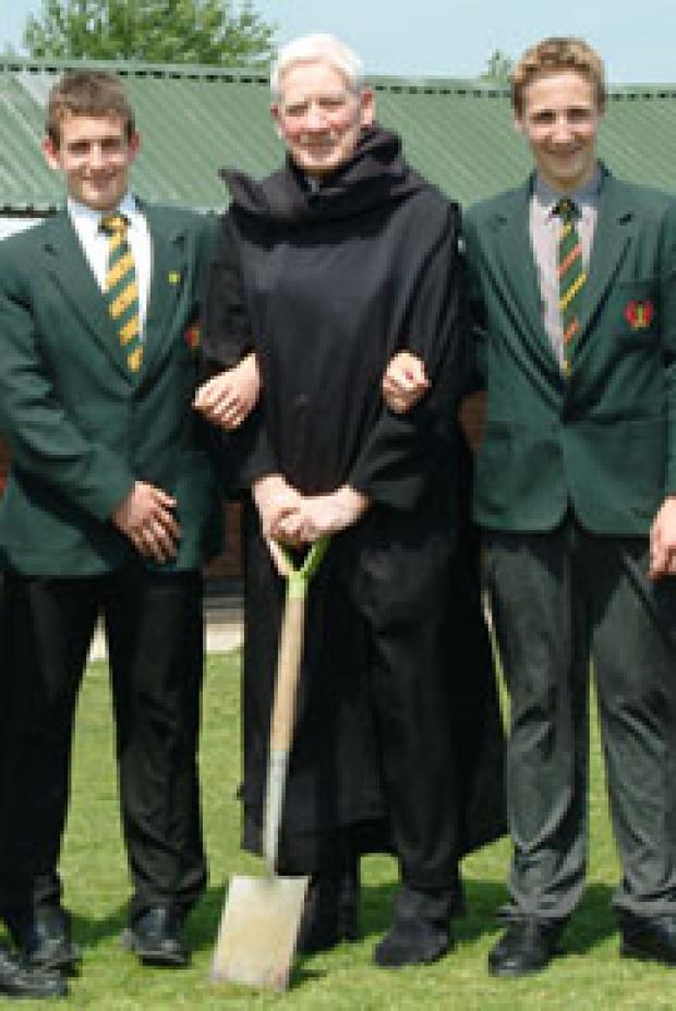 Ealing Times: Father Bernard Orchard pictured with pupils of St Benedict's School