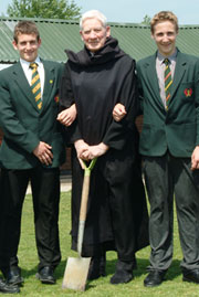 Father Bernard Orchard pictured with pupils of St Benedict's School