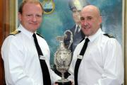 Honoured: Ian Gritt, right, receives his award from Capt Rob Bellfield, CO of HMS Raleigh