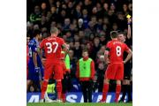 Referee Michael Oliver, far right, had his work cut out at Stamford Bridge