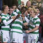 Ealing Times: Dedryck Boyata, centre, netted a late header for Celtic