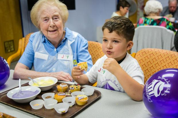 Ealing Times: Nagillah Nursery child with Anita, member of Jewish Care at Edgware and Harrow Community Centre (Photo: Yakir Zur)