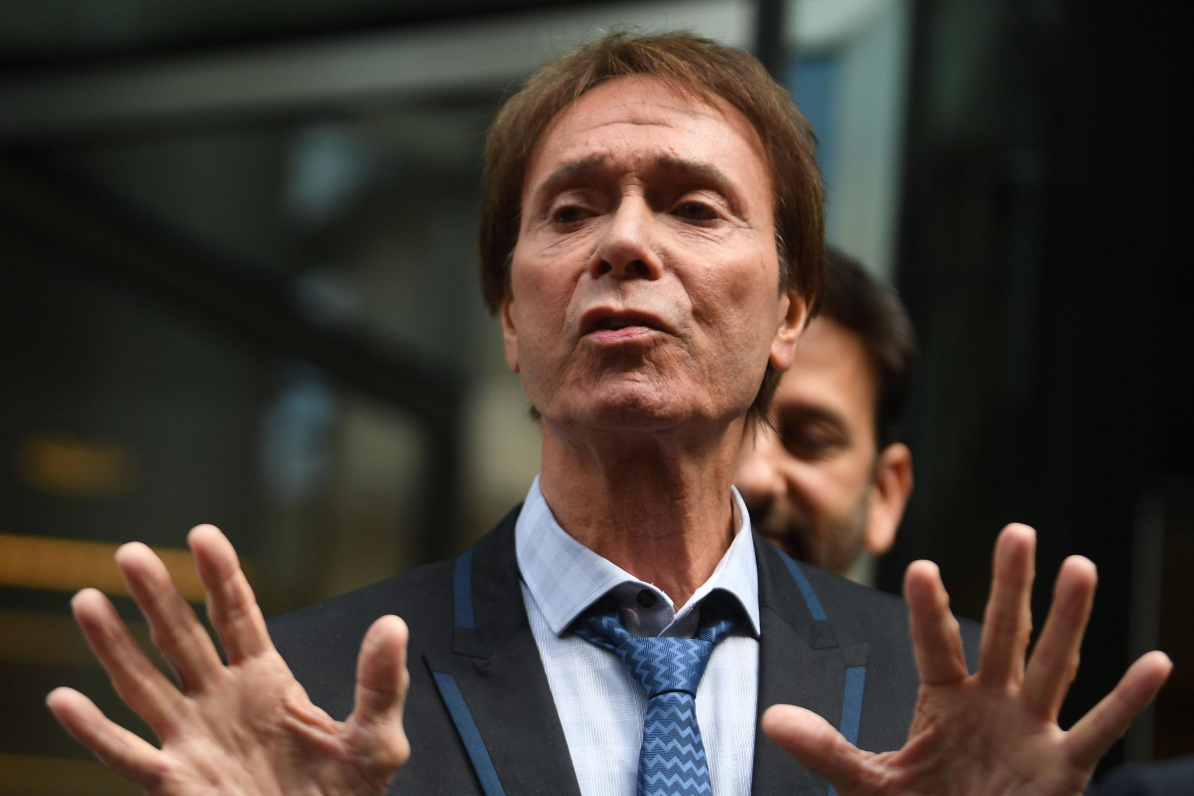 Sir Cliff Richard speaks outside the Rolls Building in London after the ruling