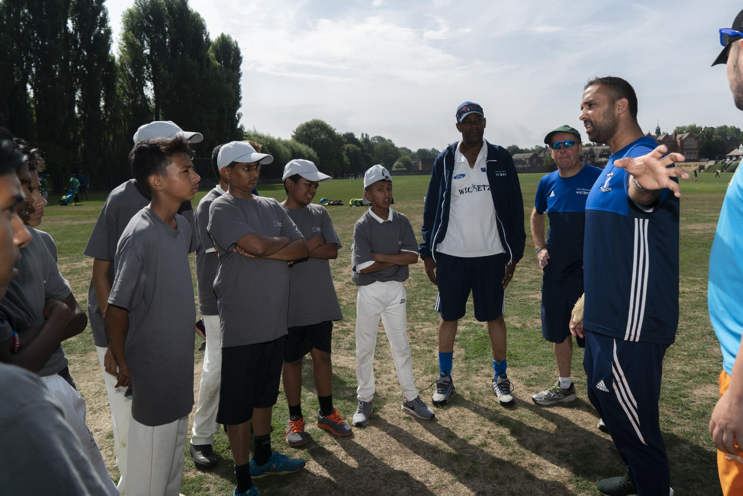 Former England bowler Kabir Ali with Tower Hamlets youngsters