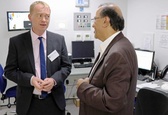 Open for business: Tim Farron with Prof Anwar Padhani of the Strickland Centre