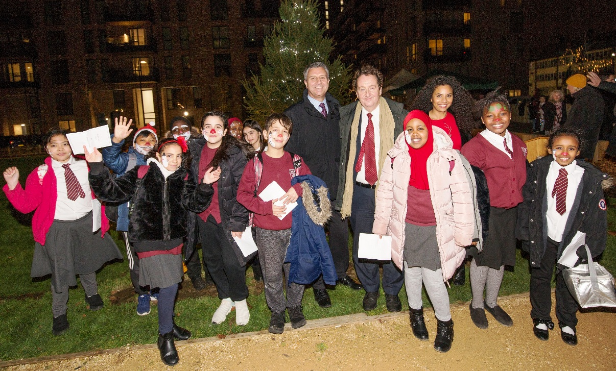 Jingle bells: children join the council leader at the switch-on